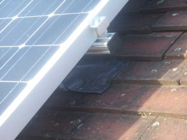 Close-up-of-Solar-Panel-Bracket-Interface-to-Roof-Tiles