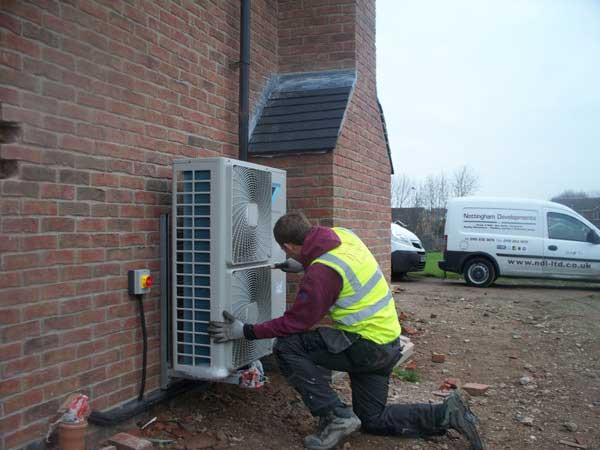 Engineer-Installing--Eco-Heat-Exchanger