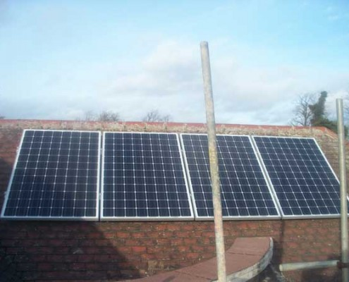 Four-Solar-Panels-on-Rood-with-Scaffold-Poles