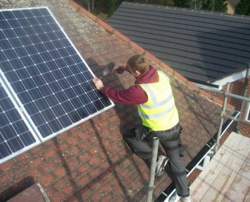 Solar-Panel-Engineer-from-Nottingham-Developments-Installing-Bracket-to-PV